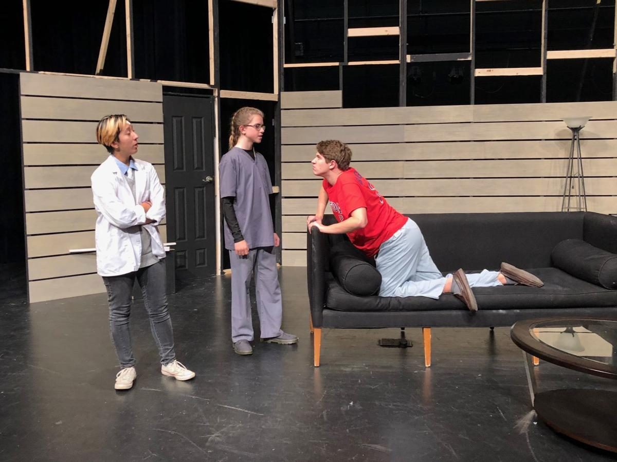 Dr. Quincy (senior Abby Rieve), left, Grimm (played by freshman Fletcher Tracy) and Renfield (junior Ben Voelker) in a scene from Calvert High School's 'Dracula: The Vampire Play.' (Dracula article; photo by Kathleen Struhar)