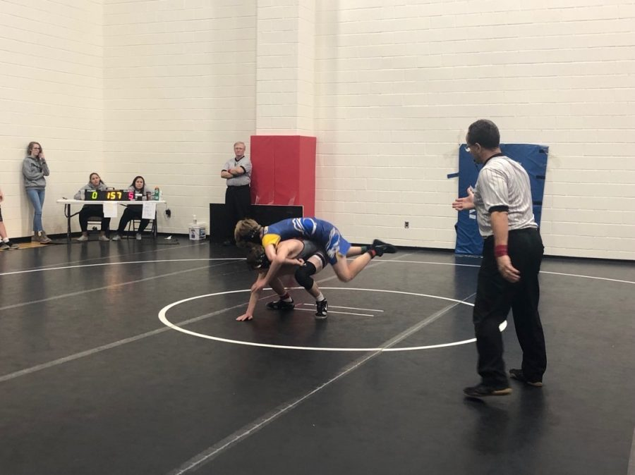 Liam Coppers is taken down by an opponent.