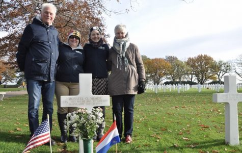 Joob Simons, Amie Dryer, Angel Gingras, and Marlise Simons at the grave of Russell O. Meade at Netherlands American Cemetery.
