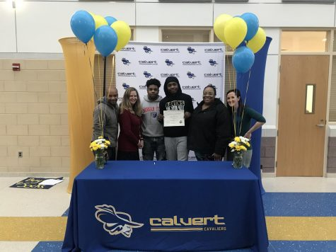 Aaron McCready holds certificate from AP Signings, surrounded by his family, along with English Teacher, Dr. Palmer and Vice Principal, Mrs. Sutton.